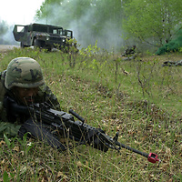 Michigan National Guard soldiers simulate humvee ambushes at Camp Ripley in Minnesota.