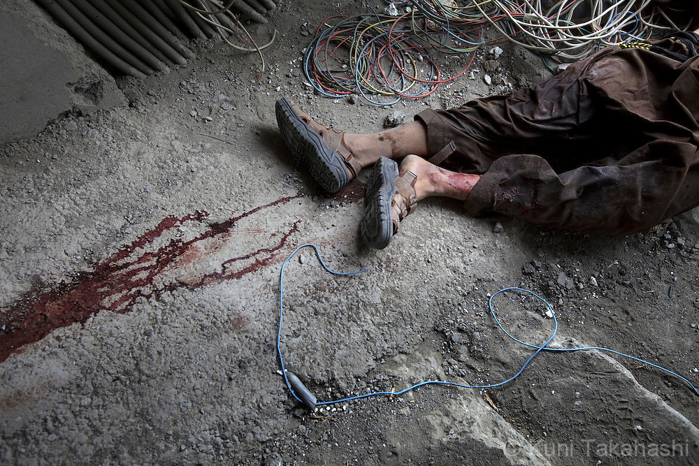 Body of one of the insurgents lies down in the building near the U.S Embassy in Kabul, Afghanistan on Sep 14, 2011 after he was killed during an operation by Afghan and NATO coalition forces. Terrorists attacked multiple locations including U.S. Embassy and a nearby NATO base in Kabul..(Photo by Kuni Takahashi)