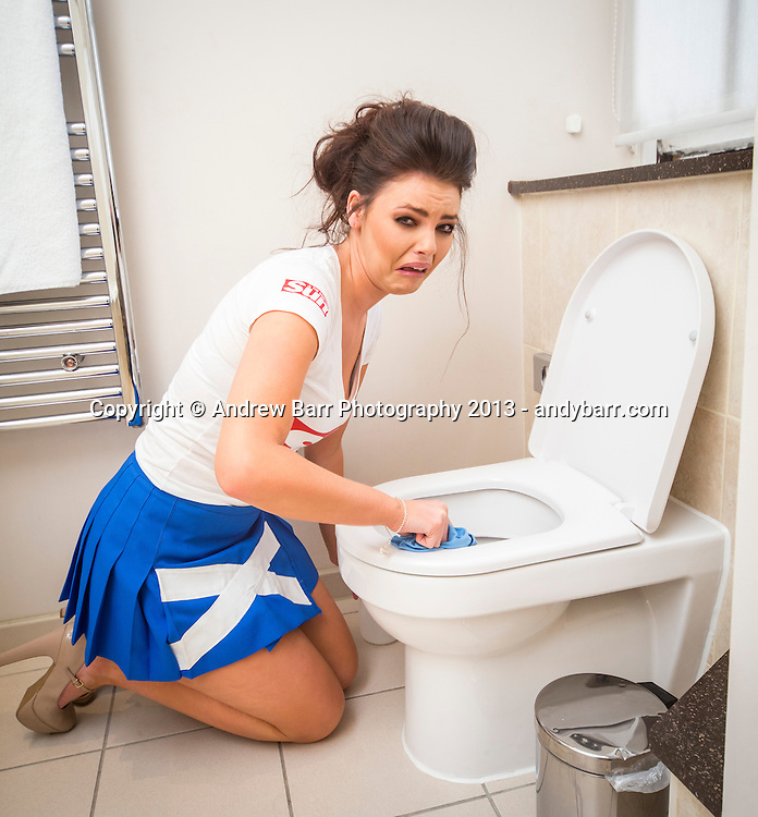 02:05:2013..Miss Scotland 2013 - chambermaid challenge at Grand Central Hotel...Louise cleans in bathroom..Pic:Andy Barr..07974 923919  (mobile).andy_snap@mac.com..All pictures copyright Andrew Barr Photography. ..Please contact before any syndication. .