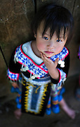 A Hmong girl in traditional clothes for the Hmong new year celebrations in the mountains near Luang Prabang, Laos.