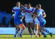 Reece Lyne (C) of Wakefield Trinity tackled by Simon Grix (L) and Jack Fairbank  (R) of Halifax RLFC during the Pre-season Friendly match at Belle Vue, Wakefield<br /> Picture by Stephen Gaunt/Focus Images Ltd +447904 833202<br /> 07/01/2018