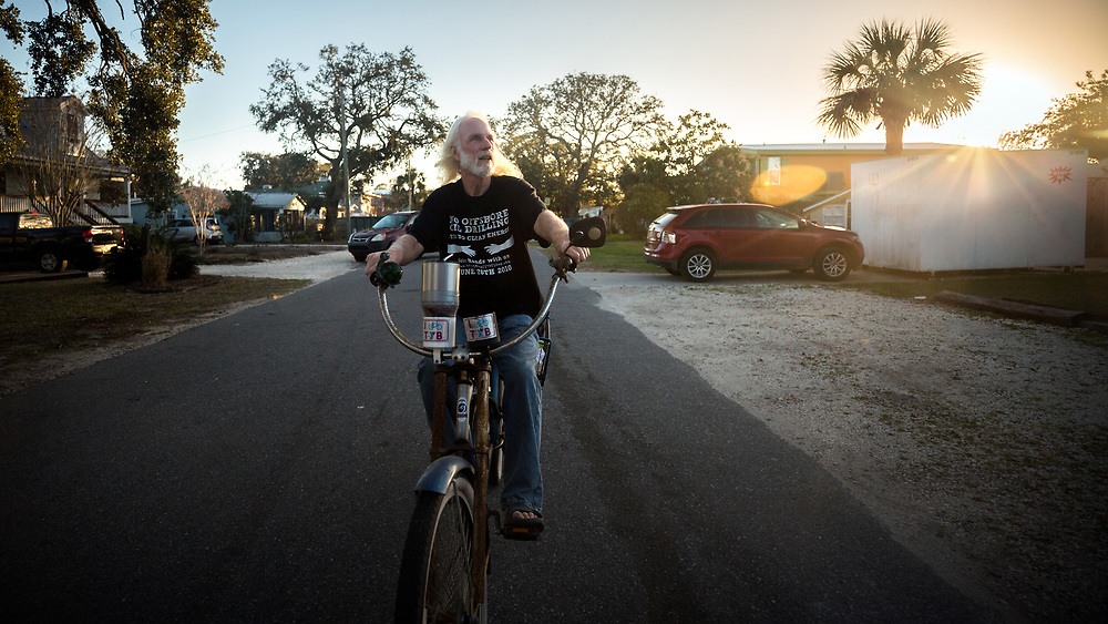 TYBEE ISLAND, GA - FEBRUARY 21, 2018: Activist Paul Wolff rides his bike on Lewis Avenue in Tybee Island, where Hurricane Irma pushed 30 inches of storm surge water into the neighborhood and flooded homes on Tybee Island. Less than a year before Hurricane Irma passed the island, Hurricane Matthew caused flooding and damage in the same neighborhood. (WABE Photo/Stephen B. Morton)
