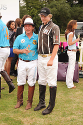 Asprey World Class Cup polo held at Hurtwood Park Polo Club, Ewhurst, Surrey on 17th July 2010.<br /> Picture shows:-Left to right, KENNEY JONES and his son CODY JONES