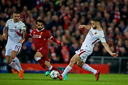 LIVERPOOL, ENGLAND - Tuesday, April 24, 2018: Liverpool's Mohamed Salah (centre) with AS Roma's Aleksandar Kolarov and Kostas Manolas during the UEFA Champions League Semi-Final 1st Leg match between Liverpool FC and AS Roma at Anfield. (Pic by David Rawcliffe/Propaganda)