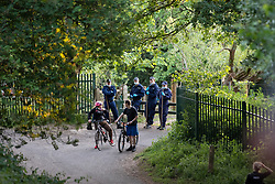© Licensed to London News Pictures. 25/05/2020. Brinnington, UK. Police have taped off a stretch of pathway in Brinnington Vale , adjacent to flats and houses . It's understood a body was recovered this afternoon (25th May 2020) . Photo credit: Joel Goodman/LNP