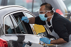 © Licensed to London News Pictures. 03/04/2020. London, UK.  An NHS staff member tests other members of the NHS for Covid-19 at a drive-through facility at IKEA Wembley in London. The facility is only available to NHS staff members. Photo credit: Ray Tang/LNP