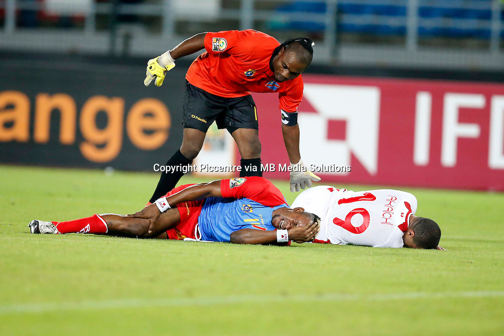 Robert Kidiaba, the Democratic Republic of Congo goalkeeper attends to injured teammate Yannick Yala Bolaise and Ahmed Akaichi of Tunisia during their AFCON match at the Estadio de Bata on January 26, 2014.The match ended 1-1.Photo/Mohammed Amin/www.pic-centre.com (Equatorial Guinea)