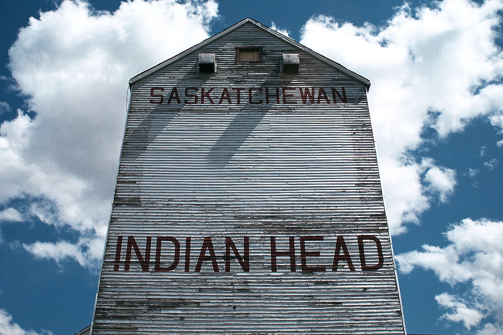 Grain elevator, Indian Head, Saskatchewan, blue sky and white clouds in background