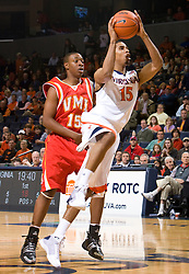 Virginia guard Sylven Landesberg (15) leaps past Virginia Military forward Ron Burks (15) towards the basket.The Virginia Cavaliers defeated the Virginia Military Institute Keydets 107-97 in NCAA Basketball at the John Paul Jones Arena on the Grounds of the University of Virginia in Charlottesville, VA on November 16, 2008.
