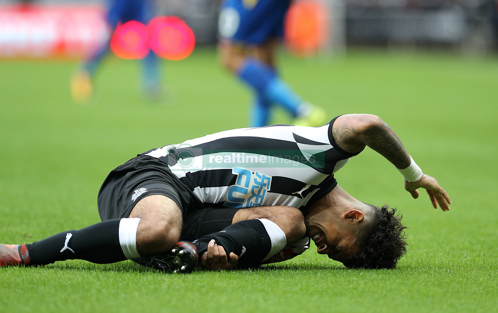 Newcastle United's DeAndre Yedlin after a tackle from Crystal Palace's Wilfried Zaha during the Premier League match at St James' Park, Newcastle.