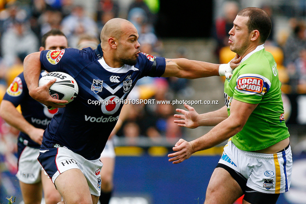 Warriors' Sam Rapira fends off Raiders' Terry Campese. NRL Rugby League match, Warriors v Raiders at Mt Smart Stadium, Auckland, New Zealand. Sunday 23 August 2009. Photo: PHOTOSPORT