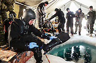 Leading seamen Deirdre Doiron, a Canadian Forces navy diver, prepares for a training dive under the six feet thick ice pack at Gascoyne Inlet, off Devon Island, Nunavut. The water temperature is 4C. To beef up Canada's military presence in the North, Canadian authorities plan to install electronic sensors on the sea bed to monitor surface and underwater traffic as climate warming creates new waterways. April 2012.