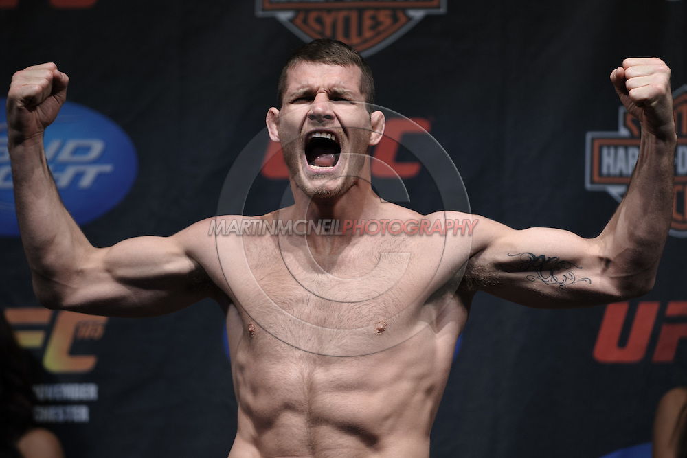 MANCHESTER, ENGLAND, NOVEMBER 13, 2009: Michael Bisping poses on the scales during the weigh-ins for UFC 105 at the MEN Arena in Manchester, England on November 13, 2009.