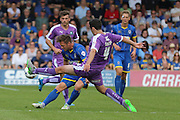 Dannie Bulman of AFC Wimbledon tussles with Carl McHugh during the Sky Bet League 2 match between AFC Wimbledon and Plymouth Argyle at the Cherry Red Records Stadium, Kingston, England on 8 August 2015. Photo by Stuart Butcher.