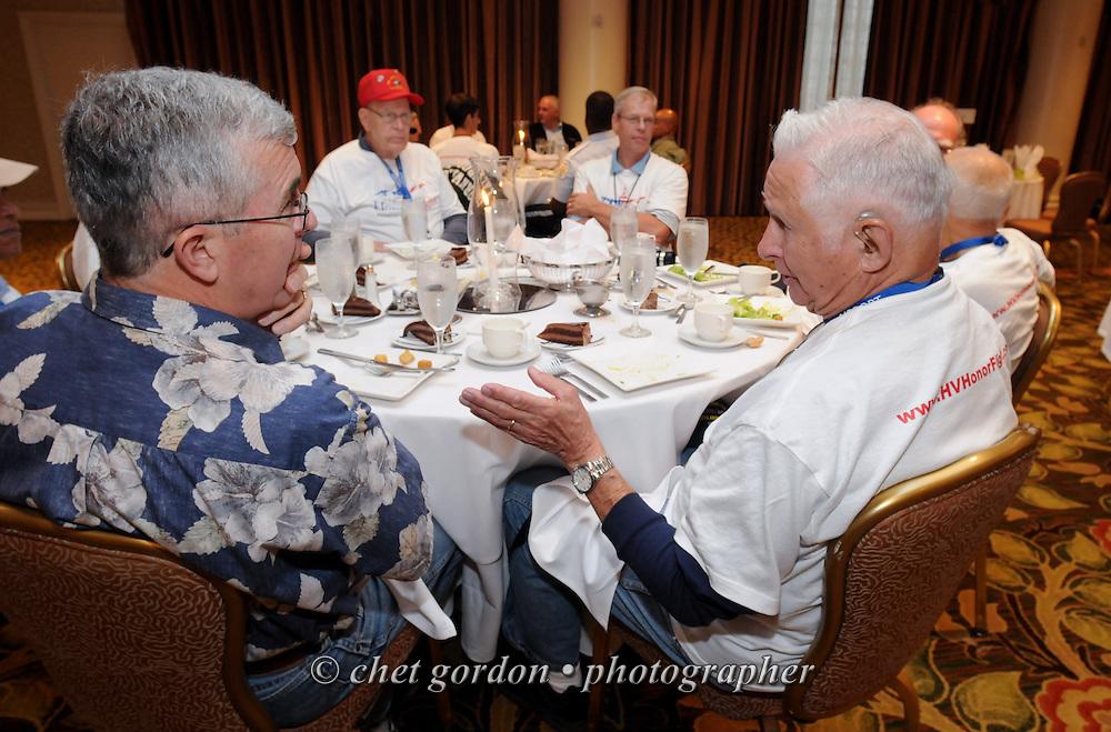 ARLINGTON, VA.  WWII Veterans and their escorts onboard the Hudson Valley Honor Flight during dinner at the Doubletree Hotel in Arlington, VA on Saturday, September 21, 2013.  © www.chetgordon.com