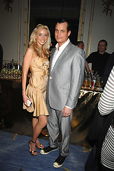 MATTHEW MELLON and NOEL RENO at a party to celebrate the launch of The Essential Party Guide held at the Mandarin Oriental Hyde Park, 66 Knightsbridge, London on 27th March 2007.<br />
