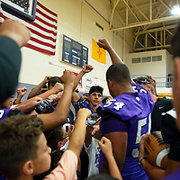 Miyamura High School football players and campers huddle during their football kiddie camp Thursday, August 1 in Gallup.