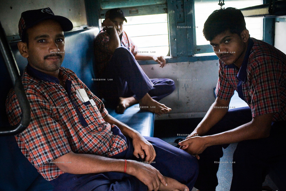 L-R  on 9th July 2009.Vinay K.R. Yadav aged 25, Sajan Kumar Yadav aged 22 and Satyender Prasad aged 23 all hail from Bihar. They live and work 6 and a half days a week onboard the Himsagar Express as it through India.. .6318 / Himsagar Express, India's longest single train journey, spanning 3720 kms, going from the mountains (Hima) to the seas (Sagar), from Jammu and Kashmir state of the Indian Himalayas to Kanyakumari, which is the southern most tip of India...Photo by Suzanne Lee / for The National