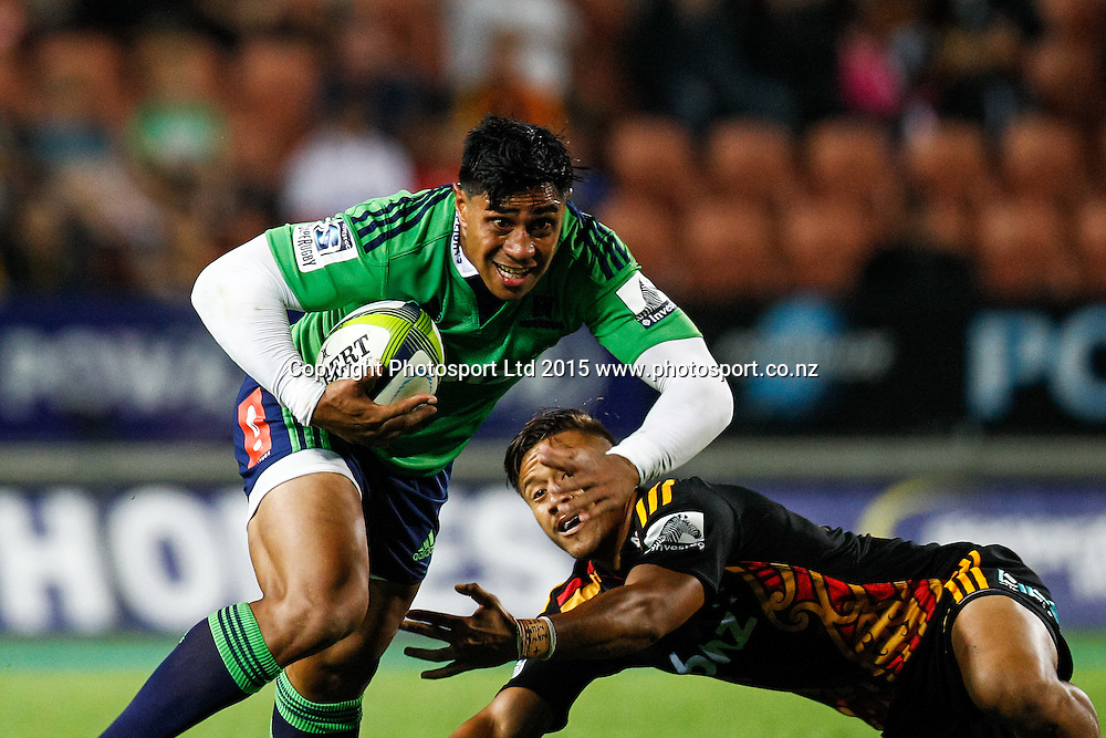 Highlander's Malakai Fekitoa beats the tackle of Chief's Tim Nanai-Williams during the Super 15 Rugby Match - Chiefs v Highlanders, 6 March 2015 at Waikato Stadium, Hamilton, New Zealand on Friday 6 March 2015.  Photo:  Bruce Lim / www.photosport.co.nz