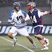 Ryan Boyle #14 of the Boston Cannons keeps the ball away from Kevin Drew #19 of the Charlotte Hounds during the game at Harvard Stadium on May 17, 2014 in Boston, Massachuttes. (Photo by Elan Kawesch)