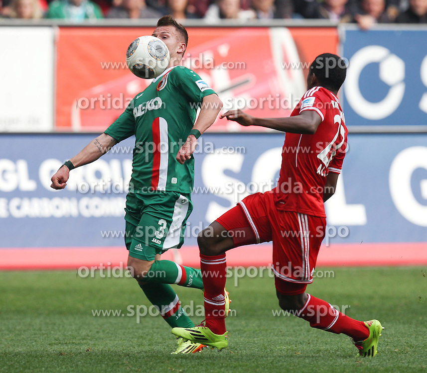 05.04.2014, SGL Arena, Augsburg, GER, 1. FBL, FC Augsburg vs FC Bayern Muenchen, 29. Runde, im Bild l-r: im Zweikampf, Aktion, mit Ronny Philp #3 (FC Augsburg) und David Alaba #27 (FC Bayern Muenchen) // during the German Bundesliga 29th round match between FC Augsburg and FC Bayern Munich at the SGL Arena in Augsburg, Germany on 2014/04/05. EXPA Pictures &copy; 2014, PhotoCredit: EXPA/ Eibner-Pressefoto/ Kolbert<br /> <br /> *****ATTENTION - OUT of GER*****