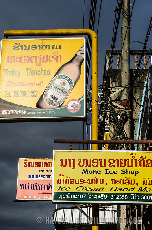 A mishmash of advertising signs on the outside of restaurants and shops in in Phonsavan in northeastern Laos, capital of Xieng Khouang Province and a central town in the Plain of Jars. The people of the region are predominantly of Hmong ethnicity.