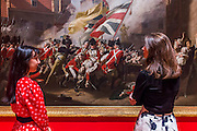 John Singleton Copley's The Death of Major Peirson, 6 January 1781 1783 - Fighting History, an exhibition celebrating the enduring significance and emotional power of British history painting at the Tate Britain. The exhibition looks at how artists have transformed significant events into paintings that encourage us to reflect on our own place in history. The works in the show range from huge oil paintings from the 18th century to a recent work by Malcolm Morley which includes a canon from HMS Victory protruding from the canvas. Highlights include: John Singleton Copley's The Death of Major Peirson, 6 January 1781 1783, a dramatic battle scene which is approximately 4 metres wide by 3 metres high; Dexter Dalwood's famous work The Poll Tax Riots 2005 which shows a sea of angry protesters surging down Whitehall towards Big Ben; Allen Jones' The Battle of Hastings 1961-2 juxtaposed with Philip James de Loutherbourg's The Battle of the Nile 1800; Malcolm Morley's Trafalgar – Waterloo 2013, a large triptych depicting Admiral Lord Nelson and the Duke of Wellington separated by a 3D cannon from the HMS Victory in the central panel. Fighting History is at Tate Britain from 9 June to 13 September 2015.