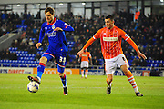 Timmy Thiele of Oldham Athletic (On loan from Burton Albion) holds off Lloyd Jones of Blackpool FC during the Sky Bet League 1 match between Oldham Athletic and Blackpool at SportsDirect.Com Park, Oldham, England on 15 March 2016. Photo by Mike Sheridan.