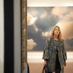 London, UK - 31 January 2013: A visitor walks in front of an oil on canvas of 1976 entitled 'Wolke (Cloud)' by Gerhard Richter (Est. £7-9 million) during the press preview of the forthcoming Sotheby's February sales of Impressionist & Modern Art and Contemporary Art in London, including works by Picasso, Bacon, Monet, Richter, Miró, Basquiat.