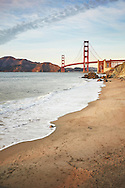 Scenic view of Golden Gate Bridge at dusk with Marshall's Beach in the foreground. San Francisco, California, USA