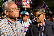 "15 JANUARY 2014 - BANGKOK, THAILAND: SUTHEP THAUGSUBAN, former Deputy Prime Minister of Thailand and leader of the Shutdown Bangkok anti-government protests, walks up Sukhumvit Road in Bangkok leading a protest march. Tens of thousands of Thai anti-government protestors continued to block the streets of Bangkok Wednesday to shut down the Thai capitol. The protest, ""Shutdown Bangkok,"" is expected to last at least a week. Shutdown Bangkok is organized by People's Democratic Reform Committee (PRDC). It's a continuation of protests that started in early November. There have been shootings almost every night at different protests sites around Bangkok. The malls in Bangkok are still open but many other businesses are closed and mass transit is swamped with both protestors and people who had to use mass transit because the roads were blocked.    PHOTO BY JACK KURTZ"