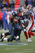 SEATTLE - NOVEMBER 28:  Free safety Ken Hamlin #26 of the Seattle Seahawks gets a block by teammate Isaiah Kacyvenski #58 while avoiding a tackle by wide receiver Eric Moulds #80 of the Buffalo Bills after Hamlin pulled down one of his two interceptions for the day at Qwest Field on November 28, 2004 in Seattle, Washington. The Bills defeated the Seahawks 38-9. ©Paul Anthony Spinelli *** Local Caption *** Ken Hamlin;Eric Moulds
