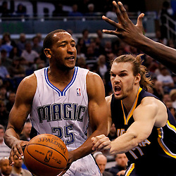 March 11, 2012; Orlando, FL, USA; Orlando Magic point guard Chris Duhon (25) drives past Indiana Pacers center Louis Amundson (17) during the second quarter of a game at  Amway Center.   Mandatory Credit: Derick E. Hingle-US PRESSWIRE