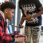 WASHINGTON, DC - MAR23: Washington Wizard Kelly Oubre, listens to a song written by senior Tyrese Rowe as Tyrese single along with his iPhone to Kelly, during a visit by Oubre to the Duke Ellington School of the Arts, March 23, 2017. (Photo by Evelyn Hockstein/For The Washington Post)