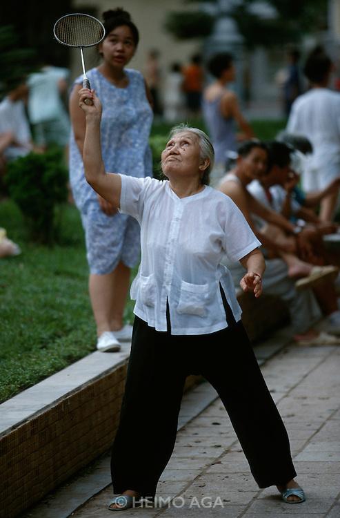 Ho Hoan Kiem (Little Lake). Old lady playing badminton.