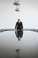 Business man standing at conference table