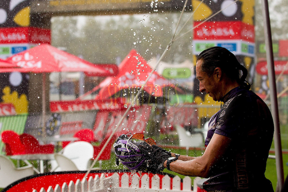 Bart Brentjens uses natures shower to clean up after stage 5 of the 2012 Absa Cape Epic Mountain Bike stage race from the Overberg Primary & High School in Caledon to Oak Valley Wine Estate in the Elgin Valley, South Africa on the 30 March 2012..Photo by Sven Martin/Cape Epic/SPORTZPICS