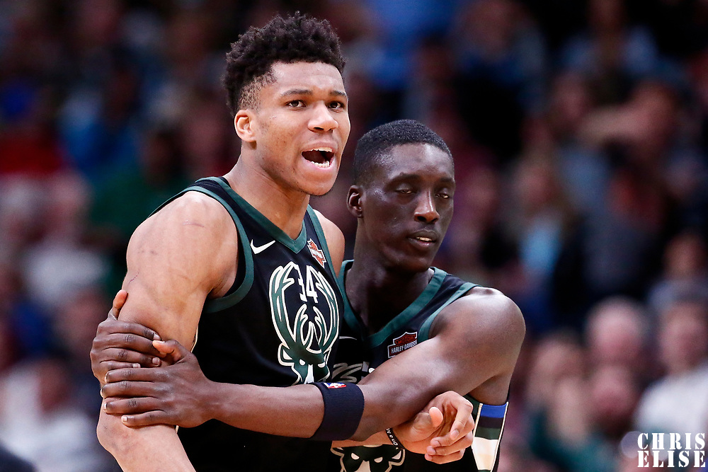 01 April 2018: Milwaukee Bucks forward Giannis Antetokounmpo (34) is restrained by Milwaukee Bucks guard Tony Snell (21) during the Denver Nuggets 128-125 victory over the Milwaukee Bucks, at the Pepsi Center, Denver, Colorado, USA.