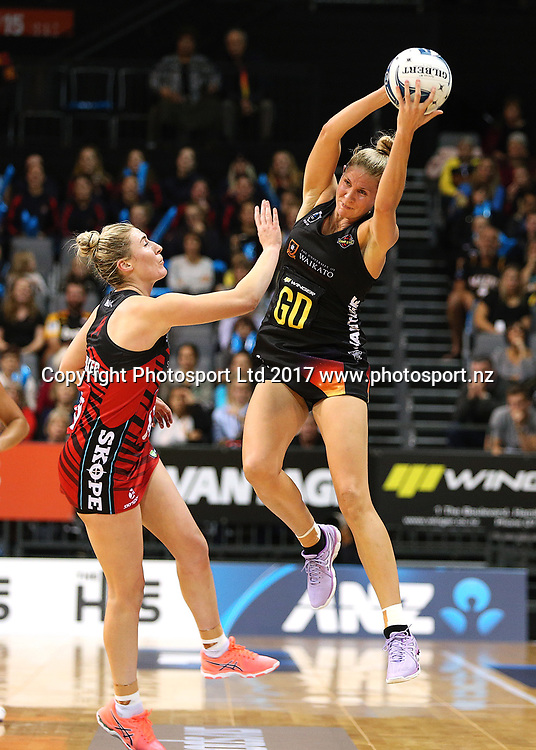 Magic captain Casey Kopua takes a pass under pressure from Tactix goal defense Zoe Walker during the ANZ Premiership netball match - Magic v Tactix played at Claudelands Arena, Hamilton, New Zealand on Monday 29 May 2017. Copyright photo: Bruce Lim / www.photosport.nz
