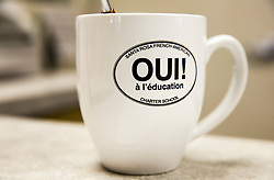 Scenes of  the Santa Rosa French-American Charter School in Santa Rosa,  California .  A mug with the school name in the office.