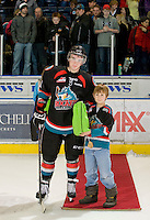 KELOWNA, CANADA, DECEMBER 3: Carter Rigby #11 of the Kelowna Rockets earns the third star of the game as the Prince George Cougars visit the Kelowna Rockets  on December 3, 2011 at Prospera Place in Kelowna, British Columbia, Canada (Photo by Marissa Baecker/Shoot the Breeze) *** Local Caption ***