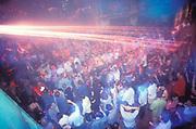 People dancing in a rave, U.K, 1999.