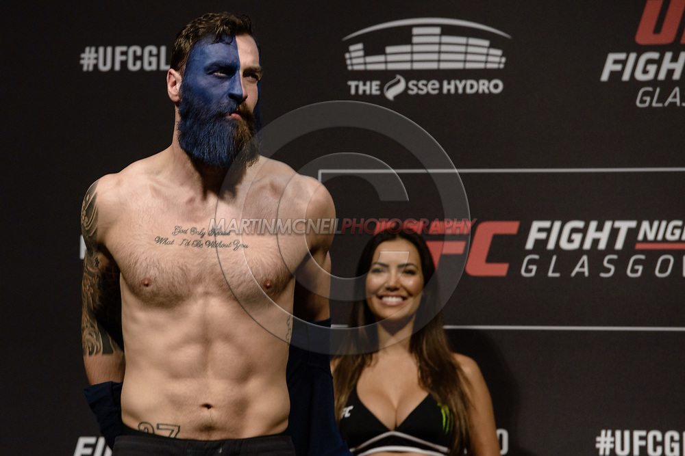"""GLASGOW, UNITED KINGDOM, JULY 15, 2017: Paul Craig on stage during the ceremonial weigh-in for """"UFC Fight Night Glasgow: Nelson vs. Ponzinibbio"""" inside the SSE Hydro Arena in Glasgow"""