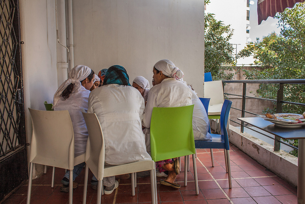 "Casablanca, March 2015. All the girls helped by the association ""Solidarité feminine"", have the opportunity to work in the restaurant and hammam created by the will of the founder Aicha Ech-Channa. In this image the girls all have lunch together, after finishing work at the restaurant."