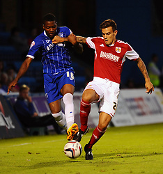 Bristol City's Marlon Pack and Gillingham's Antonio German battle for the ball - Photo mandatory by-line: Seb Daly/JMP - Tel: Mobile: 07966 386802 06/08/2013 - SPORT - FOOTBALL - Priestfield Stadium - Gillingham -  Gillingham V Bristol City - Capital One Cup - First Round