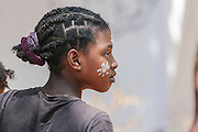Madagascar, young woman with painted face