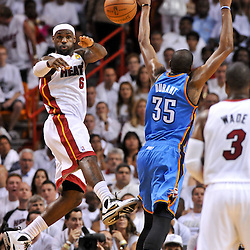 Jun 17, 2012; Miam, FL, USA; Miami Heat shooting guard Dwyane Wade (3) passes to shooting guard Dwyane Wade (3) past Oklahoma City Thunder small forward Kevin Durant (35) during the first quarter in game three in the 2012 NBA Finals at the American Airlines Arena. Mandatory Credit: Derick E. Hingle-US PRESSWIRE