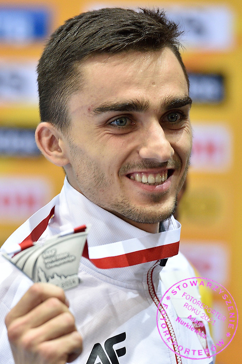Adam Kszczot of Poland poses with his silver medal while medal's ceremony after men's 800 meters final during the IAAF Athletics World Indoor Championships 2014 at Ergo Arena Hall in Sopot, Poland.<br /> <br /> Poland, Sopot, March 9, 2014.<br /> <br /> Picture also available in RAW (NEF) or TIFF format on special request.<br /> <br /> For editorial use only. Any commercial or promotional use requires permission.<br /> <br /> Mandatory credit:<br /> Photo by &copy; Adam Nurkiewicz / Mediasport