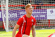 Crawley Town defender Josh Yorwerth (15) warms up before kick off during the EFL Sky Bet League 2 match between Crawley Town and Carlisle United at the Checkatrade.com Stadium, Crawley, England on 30 September 2017. Photo by Andy Walter.