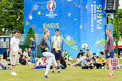 Fans play football at the Paris Fanzone, while waiting for the next game to start on the big screens. Images from the UEFA EURO 2016, 14 June 2016 in Fan Zone. (c) Paul Roberts | Edinburgh Elite media. All Rights Reserved